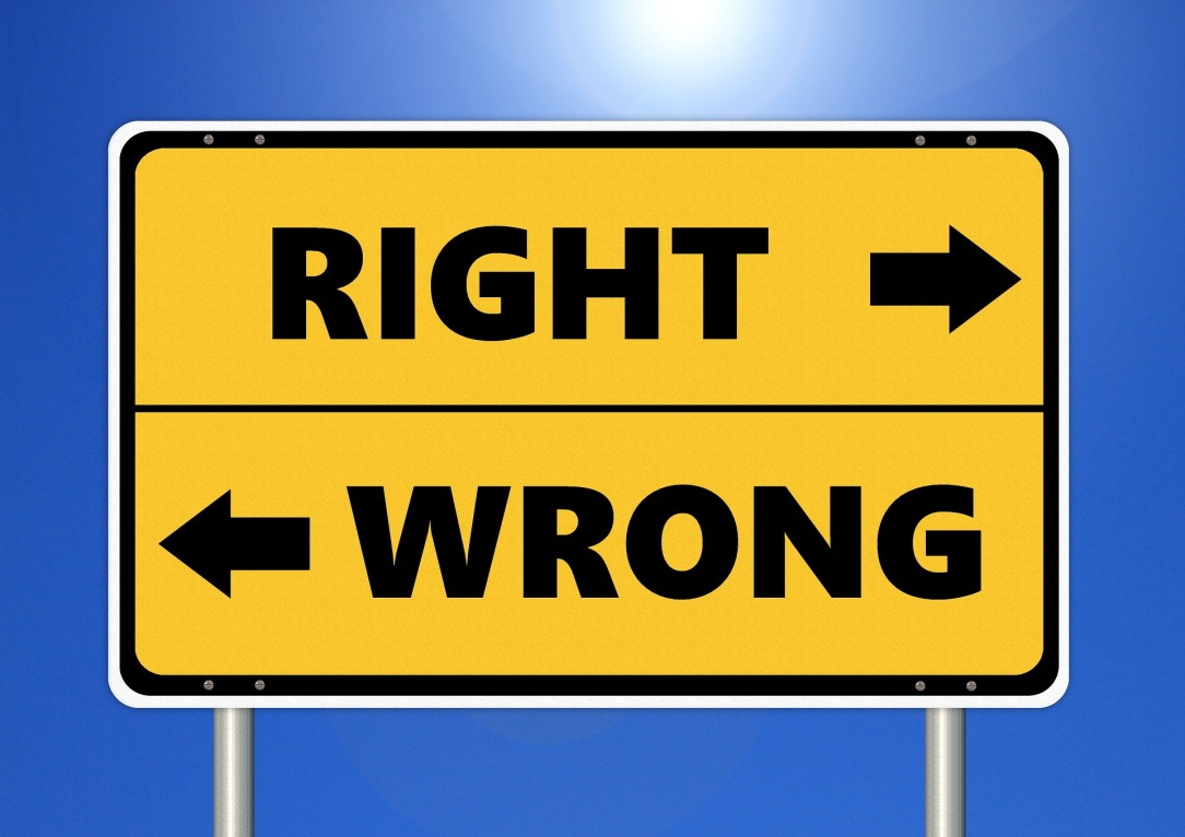 "A street sign labeled ""right"" and ""wrong"" with arrows pointing in opposite directions."