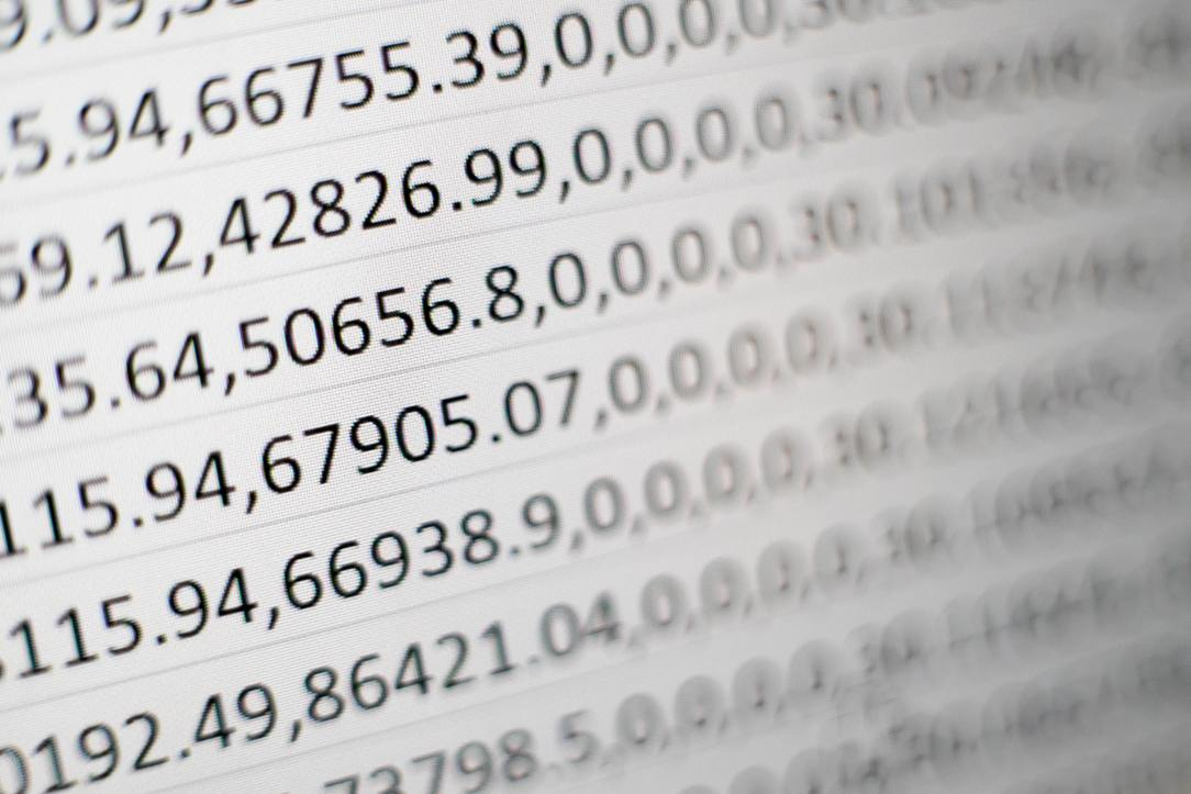 A close-up picture of numberical data, presented in rows of comma-separated values
