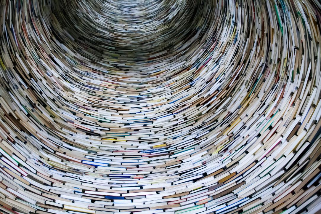 A tunnel lined with books, viewed from a low angle